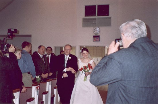Dad and Heather walking down the aisle