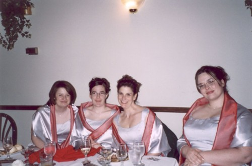The bridesmaids relaxing at the reception